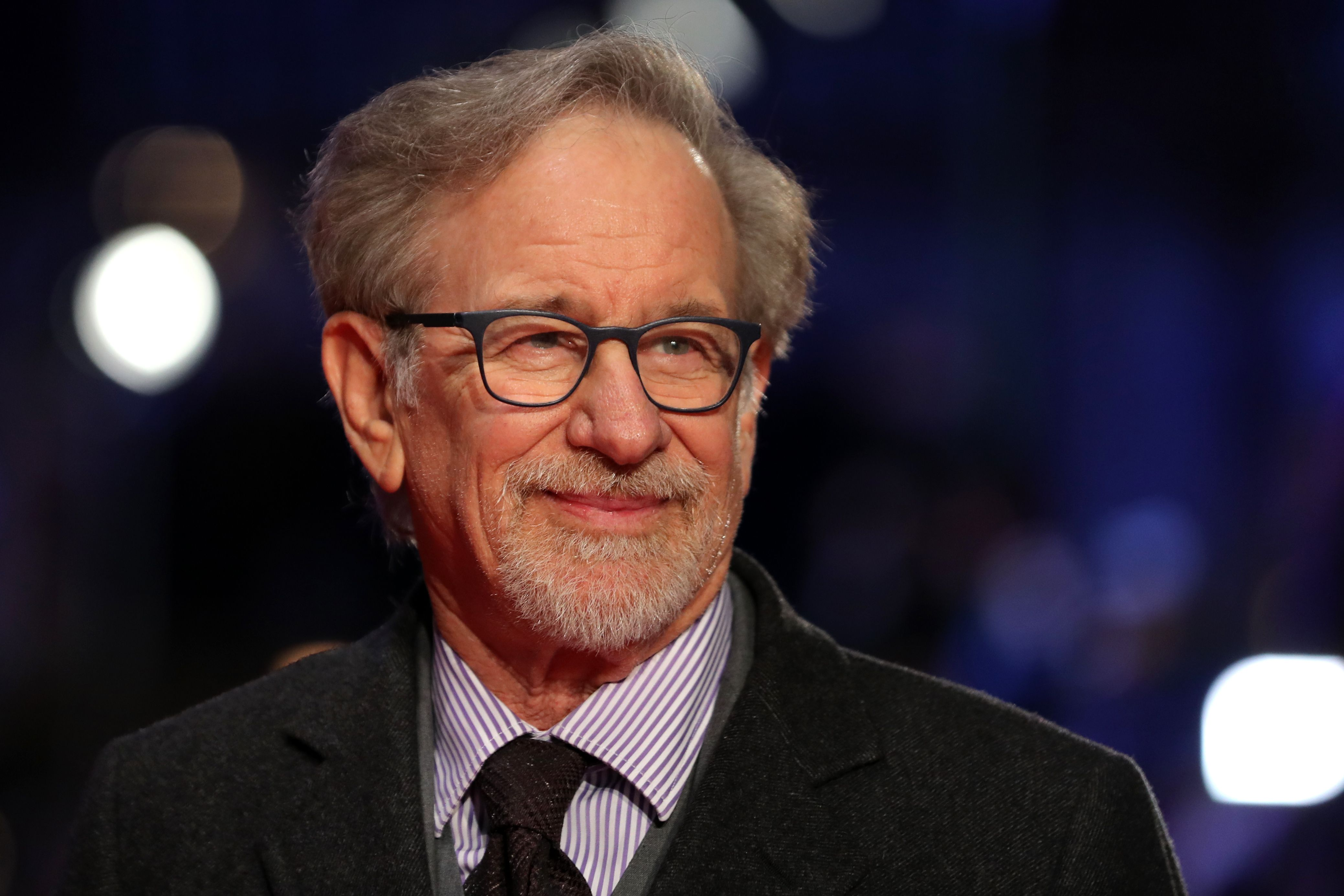 """(FILES) In this file photo taken on January 10, 2018 US film director Steven Spielberg poses on the red carpet on arrival for the European Premiere of his film, The Post in London. It's one of the most beloved movies in musical cinema and now Steven Spielberg is giving """"West Side Story"""" a makeover -- except this time, he is recruiting Latino talent to play the lead roles. The original film version of Leonard Bernstein's musical -- Shakespeare's """"Romeo and Juliet"""" reimagined in the world of warring New York gangs -- came out in 1961, winning 10 Oscars and captivating a generation on the cusp of huge societal change.For the remake, Spielberg is teaming up with playwright and screenwriter Tony Kushner, who has previously collaborated with the three-time Oscar-winning billionaire director on """"Lincoln"""" (2012) and """"Munich"""" (2005). / AFP PHOTO / Daniel LEAL-OLIVAS"""