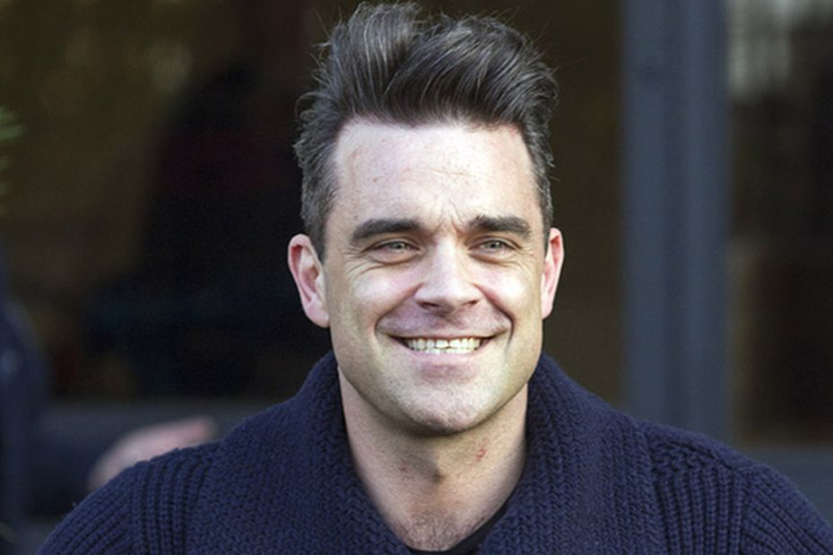 Singer Robbie Williams is pictured arriving at the ITV studios for a guest appearance on the 'Alan Carr: Chatty Man' show.<P>Pictured: Robbie Williams<P><B>Ref: SPL503198  270213  </B><BR/>Picture by: Simon Earl / Splash News<BR/></P><P><B>Splash News and Pictures</B><BR/>Los Angeles:310-821-2666<BR/>New York:212-619-2666<BR/>London:870-934-2666<BR/>photodesk@splashnews.com<BR/></P>